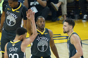 Andre Iguodala #9 of the Golden State Warriors celebrates with Stephen Curry #30 and Klay Thompson #11 against the Toronto Raptors during Game Six of the 2019 NBA Finals at ORACLE Arena on June 13, 2019 in Oakland, California. NOTE TO USER: User expressly acknowledges and agrees that, by downloading and or using this photograph, User is consenting to the terms and conditions of the Getty Images License Agreement.