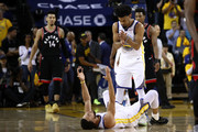 Stephen Curry #30 and Quinn Cook #4 of the Golden State Warriors react against the Toronto Raptors in the second half during Game Three of the 2019 NBA Finals at ORACLE Arena on June 05, 2019 in Oakland, California. NOTE TO USER: User expressly acknowledges and agrees that, by downloading and or using this photograph, User is consenting to the terms and conditions of the Getty Images License Agreement.