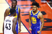 Draymond Green #23 and Quinn Cook #4 of the Golden State Warriors celebrates the play against the Toronto Raptors in the second half` during Game Two of the 2019 NBA Finals at Scotiabank Arena on June 02, 2019 in Toronto, Canada.  NOTE TO USER: User expressly acknowledges and agrees that, by downloading and or using this photograph, User is consenting to the terms and conditions of the Getty Images License Agreement.