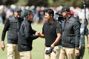 Cameron Smith of Australia and the International team congratulates Hideki Matsuyama of Japan and the International team after Matsuyama and C.T. Pan of Taiwan and the International team defeated Webb Simpson of the United States team and Patrick Reed of the United States team 1up on the 18th green during Thursday four-ball matches on day one of the 2019 Presidents Cup at Royal Melbourne Golf Course on December 12, 2019 in Melbourne, Australia.