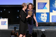 Kerry Kennedy and Nancy Pelosi speak onstage at the 2019 RFK Ripple of Hope Awards at New York Hilton Midtown on December 12, 2019 in New York City.