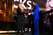 Harry Styles (R) presents Inductee Stevie Nicks (L) onstage at the 2019 Rock & Roll Hall Of Fame Induction Ceremony - Show at Barclays Center on March 29, 2019 in New York City.
