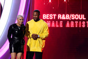 """Keyshia Cole (L) and Tank present the """"Best R&B/Soul Female Artist"""" award during the 2019 Soul Train Awards at the Orleans Arena on November 17, 2019 in Las Vegas, Nevada."""