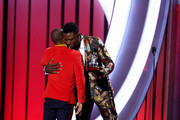 """Kirk Franklin (L) receives the """"Best Gospel/Inspirational Award"""" from Sinqua Walls during the 2019 Soul Train Awards at the Orleans Arena on November 17, 2019 in Las Vegas, Nevada."""