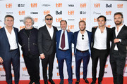 """(L-R) Alejandro Agag, Malcolm Venville, Leonardo DiCaprio, Fisher Stevens, Sam Bird, Nelson Piquet Jr. and Jean-Eric Vergne attend the """"And We Go Green"""" premiere during the 2019 Toronto International Film Festival at Ryerson Theatre on September 08, 2019 in Toronto, Canada."""