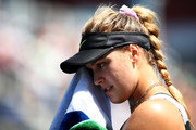 Eugenie Bouchard of Canada dries her face as she takes on Anastasija Sevastova (not pictured) of Latvia during their Women's Singles first round match during day one of the 2019 US Open at the USTA Billie Jean King National Tennis Center on August 26, 2019 in the Flushing neighborhood of the Queens borough of New York City.