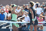 Angelique Kerber (L) of Germany congratulates Kristina Mladenovic (R) of France after their women's singles first round match during day one of the 2019 US Open at the USTA Billie Jean King National Tennis Center on August 26, 2019 in the Flushing neighborhood of the Queens borough of New York City.