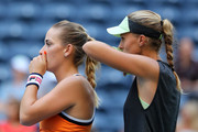 Timea Babos of Hungry and Kristina Mladenovic of France look on during their Women's Doubles quarterfinal match against Ashleigh Barty of Australia and Victoria Azarenka of Belarus on day nine of the 2019 US Open at the USTA Billie Jean King National Tennis Center on September 03, 2019 in the Queens borough of New York City.