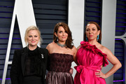 (L-R) Amy Poehler, Tina Fey, and Maya Rudolph attend the 2019 Vanity Fair Oscar Party hosted by Radhika Jones at Wallis Annenberg Center for the Performing Arts on February 24, 2019 in Beverly Hills, California.