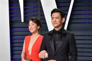 Kerri Higuchi (L) and John Cho attend the 2019 Vanity Fair Oscar Party hosted by Radhika Jones at Wallis Annenberg Center for the Performing Arts on February 24, 2019 in Beverly Hills, California.