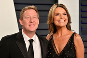 Michael Feldman (L) and Savannah Guthrie attend the 2019 Vanity Fair Oscar Party hosted by Radhika Jones at Wallis Annenberg Center for the Performing Arts on February 24, 2019 in Beverly Hills, California.