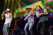 (EDITORIAL USE ONLY. NO COMMERCIAL USE) (L-R) Tyler Hubbard and Brian Kelley of Florida Georgia Line and Morgan Wallen perform onstage during the 2019 iHeartCountry Festival Presented by Capital One at the Frank Erwin Center on May 4, 2019 in Austin, Texas.