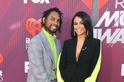 (L-R) Miguel and Nazanin Mandi attend the 2019 iHeartRadio Music Awards which broadcasted live on FOX at Microsoft Theater on March 14, 2019 in Los Angeles, California.
