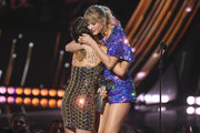 (EDITORIAL USE ONLY. NO COMMERCIAL USE)  (L-R) Maren Morris presents the Tour of the Year award for Reputation Stadium Tour to Taylor Swift on stage at the 2019 iHeartRadio Music Awards which broadcasted live on FOX at the Microsoft Theater on March 14, 2019 in Los Angeles, California.