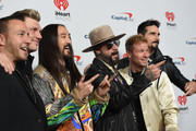 (EDITORIAL USE ONLY) Steve Aoki (C) with (L-R) Howie Dorough, Nick Carter, AJ McLean, Brian Littrell, and Kevin Richardson of Backstreet Boys attend the 2019 iHeartRadio Music Festival at T-Mobile Arena on September 20, 2019 in Las Vegas, Nevada.