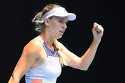 Caroline Wozniacki of Denmark celebrates after winning set point during her Women's Singles second round match against Dayana Yastremska of Ukraine on day three of the 2020 Australian Open at Melbourne Park on January 22, 2020 in Melbourne, Australia.