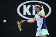 Carla Suarez Navarro of Spain plays a forehand during her Women's Singles first round match against Aryna Sabalenka of Belarus on day three of the 2020 Australian Open at Melbourne Park on January 22, 2020 in Melbourne, Australia.