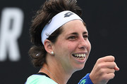 Carla Suarez Navarro of Spain celebrates after winning match point during her Women's Singles first round match against Aryna Sabalenka of Belarus on day three of the 2020 Australian Open at Melbourne Park on January 22, 2020 in Melbourne, Australia.