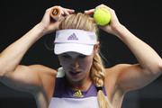 Caroline Wozniacki of Denmark adjusts her hair during her Women's Singles third round match against Ons Jabeur of Tunisia on day five of the 2020 Australian Open at Melbourne Park on January 24, 2020 in Melbourne, Australia.