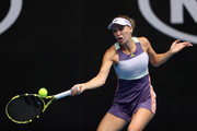 Caroline Wozniacki of Denmark plays a forehand during her Women's Singles third round match against Ons Jabeur of Tunisia on day five of the 2020 Australian Open at Melbourne Park on January 24, 2020 in Melbourne, Australia.