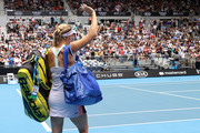 Caroline Wozniacki of Denmark acknowledges the crowd as she walks off court after losing her Women's Singles third round match against Ons Jabeur of Tunisia on day five of the 2020 Australian Open at Melbourne Park on January 24, 2020 in Melbourne, Australia.