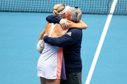 Caroline Wozniacki's coach and father Piotr Wozniacki lifts her up after her Women's Singles third round match against Ons Jabeur of Tunisia day five of the 2020 Australian Open at Melbourne Park on January 24, 2020 in Melbourne, Australia.