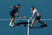 Pat Cash (L) and Mark Woodforde of Australia play in their Men's Legends Doubles match against Thomas Muster of Austria and Mats Wilander of Sweden on day eight of the 2020 Australian Open at Melbourne Park on January 27, 2020 in Melbourne, Australia.