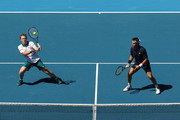 Pat Cash and Mark Woodforde of Australia play during their Men's Legends Doubles match against Thomas Muster of Austria and Mats Wilander of Sweden on day eight of the 2020 Australian Open at Melbourne Park on January 27, 2020 in Melbourne, Australia.