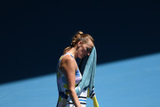 Petra Kvitova of Czech Republic wipes her face during her Women's Singles Quarterfinal match against Ashleigh Barty of Australia on day nine of the 2020 Australian Open at Melbourne Park on January 28, 2020 in Melbourne, Australia.