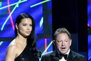 Adriana Lima (L) and Bobby Kotick speak onstage during the 2020 Breakthrough Prize at NASA Ames Research Center on November 03, 2019 in Mountain View, California.