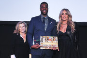 Valeria Rumori, Winston Duke and Tiziana Rocca pose for a photo at the 2020 Filming Italy Awards at the Italian Cultural Institute on January 22, 2020 in Los Angeles, California.