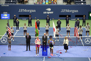 Naomi Osaka (R) of Japan holds the championship trophy and Victoria Azarenka (L) of Belarus holds the finalist trophy after being awarded them by USTA President Robert Galbraith (C) after their Women's Singles final match on Day Thirteen of the 2020 US Open at the USTA Billie Jean King National Tennis Center on September 12, 2020 in the Queens borough of New York City.