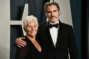 Joaquin Phoenix and mother Arlyn Phoenix attend the 2020 Vanity Fair Oscar Party hosted by Radhika Jones at Wallis Annenberg Center for the Performing Arts on February 09, 2020 in Beverly Hills, California.
