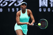 Venus Williams of The United States of America plays a backhand in her Women's Singles first round match against Kirsten Flipkens of Belgium during day one of the 2021 Australian Open at Melbourne Park on February 08, 2021 in Melbourne, Australia.