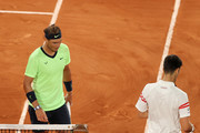 Rafael Nadal of Spain looks on during a break as he changes ends during his Men's Singles Semi Final match against Novak Djokovic of Serbia on day Thirteen of the 2021 French Open at Roland Garros on June 11, 2021 in Paris, France.