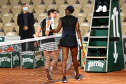 Carla Suarez Navarro of Spain congratulates Sloane Stephens of The United States on victory following their ladies singles first round match during day three of the 2021 French Open at Roland Garros on June 01, 2021 in Paris, France.