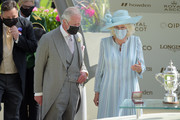 Prince Charles, Prince of Wales (L) and Camilla, Duchess of Cornwall (R) award jockey Kevin Manning (R) after he won the St James's Palace Stakes on Poetic Flare during Royal Ascot 2021 at Ascot Racecourse on June 15, 2021 in Ascot, England.