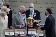 Prince Charles, Prince of Wales (C) and Camilla, Duchess of Cornwall (L) present the Prince Of Wales's Stakes during Royal Ascot 2021 at Ascot Racecourse on June 16, 2021 in Ascot, England.