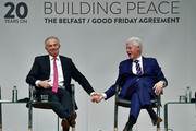 Former US President Bill Clinton holds hands with former British Prime Minister Tony Blair as they attend an event to mark the 20th anniversary of the Good Friday Agreement at Queens university on April 10, 2018 in Belfast, Northern Ireland. The event, 'Building Peace: 20 years on from the Belfast/Good Friday Agreement' has been organised by the Senator George J. Mitchell Institute for Global Peace, Security and Justice.