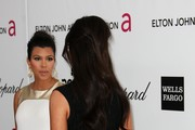 TV personalities Kourtney Kardashian (L) and Kim Kardashian arrive at the 20th Annual Elton John AIDS Foundation's Oscar Viewing Party held at West Hollywood Park on February 26, 2012 in West Hollywood, California.