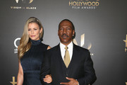 Actors Paige Butcher (L) and Eddie Murphy attend the 20th Annual Hollywood Film Awards on November 6, 2016 in Beverly Hills, California.