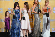 (L-R) Actresses Aubrey Anderson-Emmons, Ariel Winter, Sarah Hyland, Sofia Vergara, and Julie Bowen, winners of the Outstanding Performance by an Ensemble in a Comedy Series for 'Modern Family,' pose in the press room during the 20th Annual Screen Actors Guild Awards at The Shrine Auditorium on January 18, 2014 in Los Angeles, California.