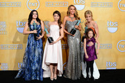 (L-R) Actresses Ariel Winter, Sarah Hyland, Sofia Vergara, Julie Bowen, and Aubrey Anderson-Emmons, winners of the Outstanding Performance by an Ensemble in a Comedy Series for 'Modern Family,' pose in the press room during the 20th Annual Screen Actors Guild Awards at The Shrine Auditorium on January 18, 2014 in Los Angeles, California.