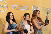 (L-R) Actresses Ariel Winter, Sarah Hyland, and Sofia Vergara, winners of the Outstanding Performance by an Ensemble in a Comedy Series for 'Modern Family,' pose in the press room during the 20th Annual Screen Actors Guild Awards at The Shrine Auditorium on January 18, 2014 in Los Angeles, California.