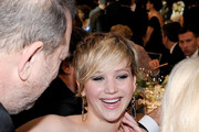 Producer Harvey Weinstein (L) and actress Jennifer Lawrence (C) in the audience during the 20th Annual Screen Actors Guild Awards at The Shrine Auditorium on January 18, 2014 in Los Angeles, California.