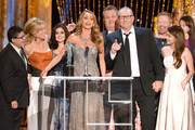 (L-R) Actors Rico Rodriguez, Julie Bowen, Ariel Winter, Sofia Vergara, Eric Stonestreet, Ed O'Neill, Jesse Tyler Ferguson, and Sarah Hyland accept the Outstanding Performance by an Ensemble in a Comedy Series award for 'Modern Family' onstage during the 20th Annual Screen Actors Guild Awards at The Shrine Auditorium on January 18, 2014 in Los Angeles, California.
