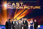 (L-R) Actors Robert De Niro, Michael Pena, Alessandro Nivola, Jeremy Renner, Colleen Camp, Elisabeth Rohm, Bradley Cooper, Jennifer Lawrence, Amy Adams, and Paul Herman accept the Outstanding Performance by a Cast in a Motion Picture award for 'American Hustle' onstage during the 20th Annual Screen Actors Guild Awards at The Shrine Auditorium on January 18, 2014 in Los Angeles, California.