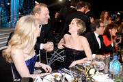 Producer Harvey Weinstein (C) and actress Jennifer Lawrence (R) in the audience during the 20th Annual Screen Actors Guild Awards at The Shrine Auditorium on January 18, 2014 in Los Angeles, California.