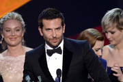(L-R) Actors Elisabeth Rohm, Bradley Cooper and Jennifer Lawrence accept the Outstanding Performance by a Cast in a Motion Picture award for 'American Hustle' onstage during the 20th Annual Screen Actors Guild Awards at The Shrine Auditorium on January 18, 2014 in Los Angeles, California.