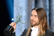 Actor Jared Leto accepts the Outstanding Performance by a Male Actor in a Supporting Role award for 'Dallas Buyers Club' onstage during the 20th Annual Screen Actors Guild Awards at The Shrine Auditorium on January 18, 2014 in Los Angeles, California.